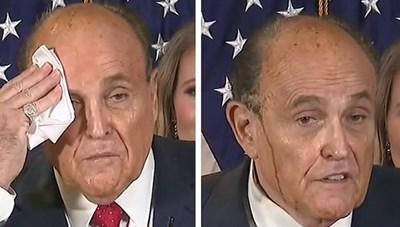 Luật sư ông Trump vã mồ hôi đến phai thuốc nhuộm tóc khi họp báo