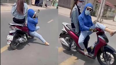 [VIDEO]: Nữ 'ninja' chở bạn trên xe máy 'làm xiếc' trên đường