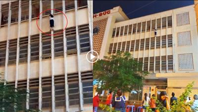 [VIDEO]: Thót tim nữ sinh treo lửng lơ ngoài ban công suýt rơi xuống sân trường