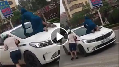 [VIDEO] Nghi chồng đi với 'tiểu tam', người phụ nữ nhảy lên nắp capo, đập vỡ kính
