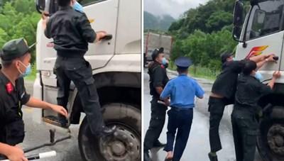 Cảnh sát đu cửa 200 m bám theo xe tải vượt chốt kiểm soát