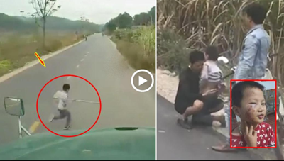 Lao sang đường, bé trai may mắn thoát chết dưới gầm container