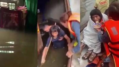 CLIP: Giải cứu 2 người dân mắc kẹt trong nước lũ, nhịn đói nhiều ngày liền