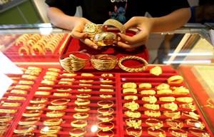 Giá vàng thế giới tăng khi đồng USD xuống giá trong phiên 5/10