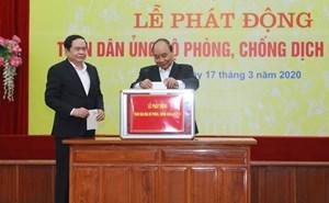 [CHÙM ẢNH] Thủ tướng Nguyễn Xuân Phúc, Chủ tịch Trần Thanh Mẫn dự Lễ Phát động Toàn dân phòng chống dịch Covid 19
