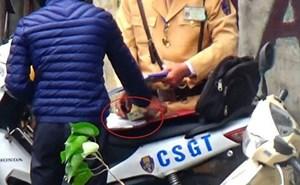 Điều tra vụ cảnh sát giao thôngHà Nộinghi nhận tiền người vi phạm