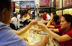 Giá vàng trong nước bật tăng, tỷ giá trung tâm giảm 7 đồng/USD