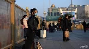 Người dân Trung Quốc quay trở lại làm việc trong bão dịch