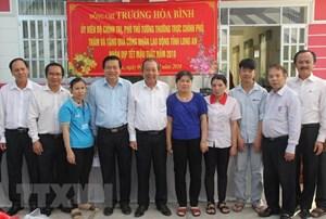 Phó Thủ tướng Trương Hòa Bình thăm, tặng quà Tết cho công nhân