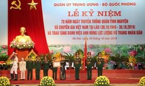 Lực lượng quân tình nguyện và chuyên gia Việt Nam tại Lào đón nhận danh hiệu Anh hùng