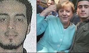 Bà Merkel chụp cùng nghi phạm khủng bố Bỉ?
