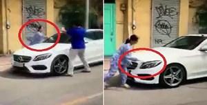 Xử lý thế nào hành vi đỗ xe chắn cửa nhà dân và phá hoại xe ô tô?