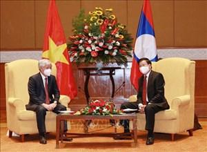 Tổng Bí thư, Chủ tịch nước Lào Thongloun Sisoulith tiếp Chủ tịch UBTƯ MTTQ Việt Nam Đỗ Văn Chiến