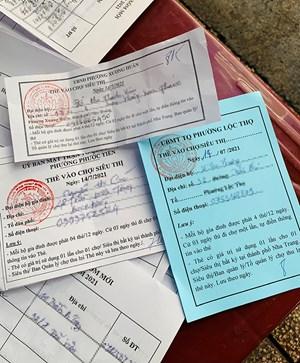 Người dân Nha Trang đi chợ bằng phiếu