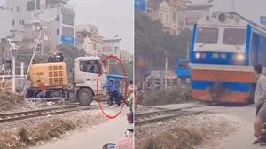 Tài xế mắc kẹt trên đường tàu hoả được người dân giải cứu