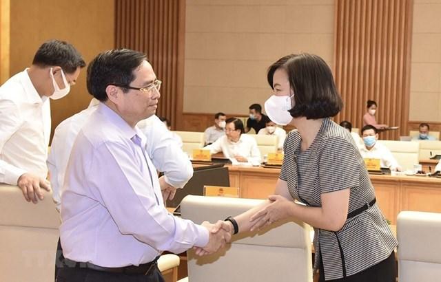 Thủ tướng Phạm Minh Chính và bà Vũ Việt Trang, Phó Tổng Giám đốc TTXVN. (Ảnh: TTXVN).