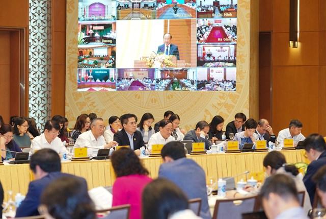 Đại biểu dự Hội nghị tại Hà Nội và các điểm cầu. Ảnh: VGP/Quang Hiếu.