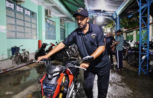 Công việc giữ xe giúp họ có đủ kinh phí trang trải cuộc sống ở Việt Nam.