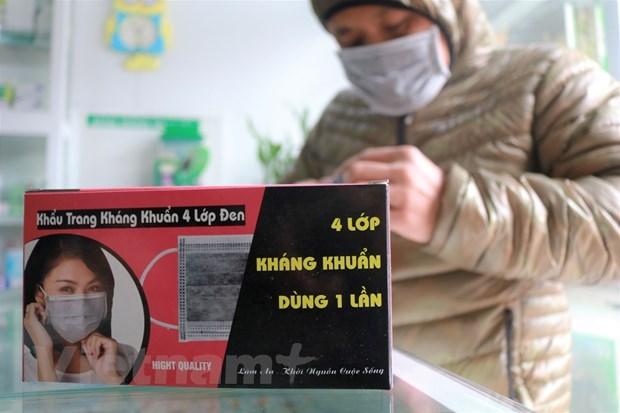 Phòng chống dịch viêm phổi Vũ Hán: Người dân đổ xô đi mua khẩu trang - 2