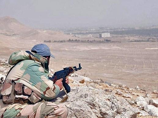 Giao tranh giành Palmyra: Cờ IS bị gỡ khỏi thành cổ - 1