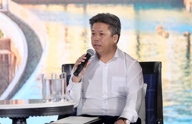 Ông Hà Văn Thanh Khương, Phó Giám đốc Sở Xây dựng tỉnh Kiên Giang phát biểu tại hội thảo.