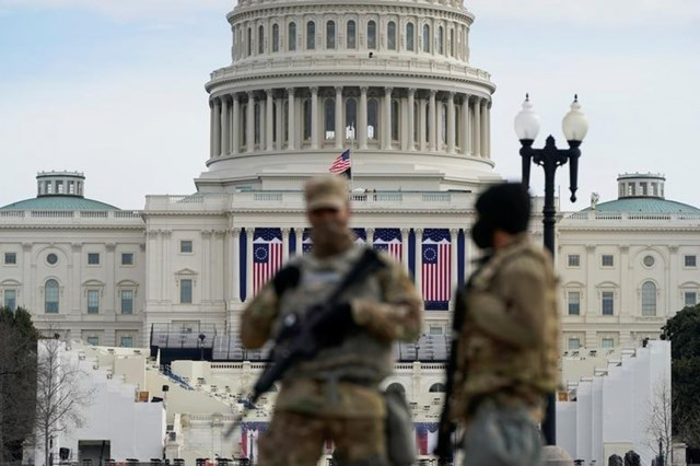 Tòa nhà Quốc hội Mỹ bị phong tỏa khi đang diễn ra diễn tập cho lễ nhậm chức tổng thống. Ảnh: Reuters.