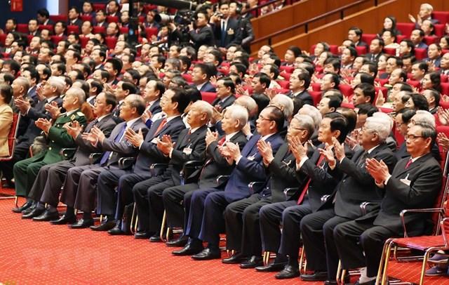 Các lãnh đạo, nguyên lãnh đạo Đảng, Nhà nước và đại biểu dự phiên khai mạc Đại hội. Ảnh: TTXVN.