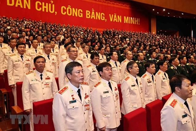 Đoàn đại biểu Đảng bộ Công an Trung ương và Đảng bộ Quân đội dự phiên khai mạc Đại hội. Ảnh: TTXVN.