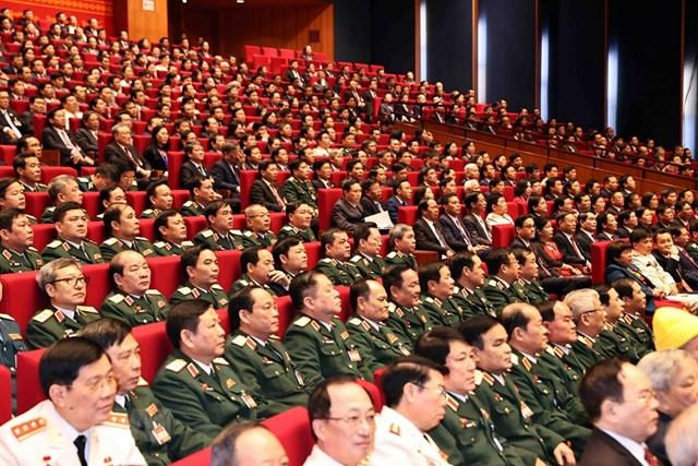 Đoàn đại biểu Đảng bộ Quân đội dự phiên khai mạc Đại hội. Ảnh: TTXVN.