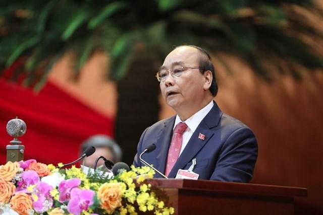 Ủy viên Bộ Chính trị, Thủ tướng Chính phủ Nguyễn Xuân Phúc thay mặt Đoàn Chủ tịch đọc Diễn văn khai mạc Đại hội. Ảnh: TTXVN.