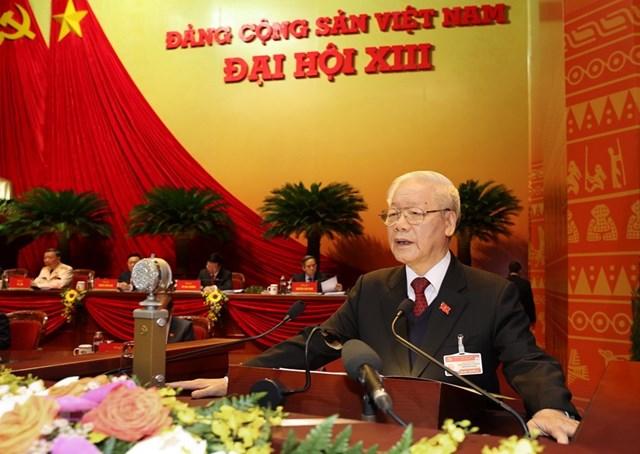 Tổng Bí thư Ban Chấp hành Trung ương Đảng, Chủ tịch nước CHXHCN Việt Nam Nguyễn Phú Trọng đọc Báo cáo chính trị của Ban Chấp hành Trung ương Đảng khóa XII và các văn kiện trình Đại hội. Ảnh: TTXVN.