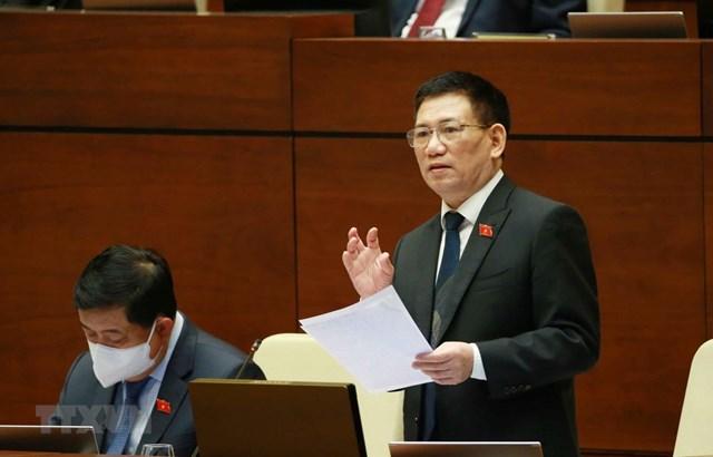 Bộ trưởng Bộ Tài Chính Hồ Đức Phớc giải trình ý kiến của đại biểu Quốc hội. Ảnh: Phương Hoa/TTXVN.