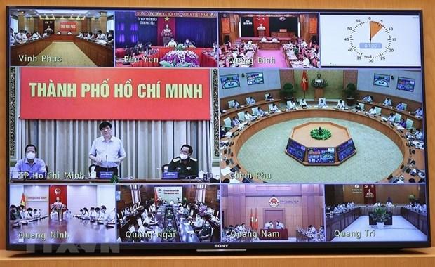 Hội nghị trực tuyến tại điểm cầu các địa phương. Ảnh: Dương Giang/TTXVN.