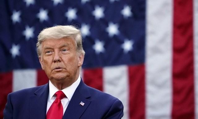 Tổng thống Mỹ Donald Trump với mái tóc xám trắng tại cuộc họp báo ở Nhà Trắng hôm 13/11. Ảnh: AFP.