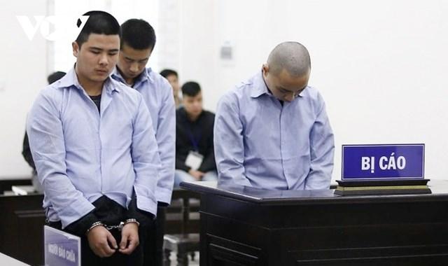 Các bị cáo tại phiên xét xử.