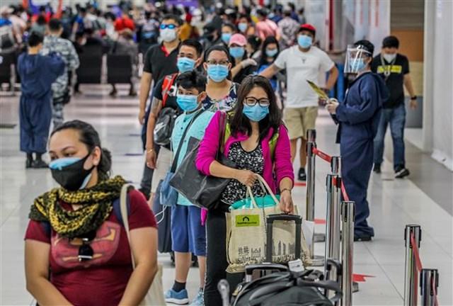 ASEAN công bố báo cáo đánh giá tác động của đại dịch Covid-19 - Ảnh 1