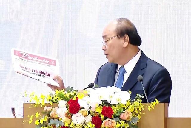 Thủ tướng Nguyễn Xuân Phúc khẳng định bản lĩnh, ý chí, khí chất của người Việt Nam đưa đất nước vượt qua khó khăn của năm 2020 - bài đăng trên Báo Đại Đoàn Kết. Ảnh: Quang Vinh.